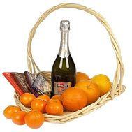 Champagne and fruits in a basket - flowers and bouquets on salonroz.com