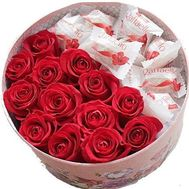 Roses and Raffaello in a round box - flowers and bouquets on salonroz.com